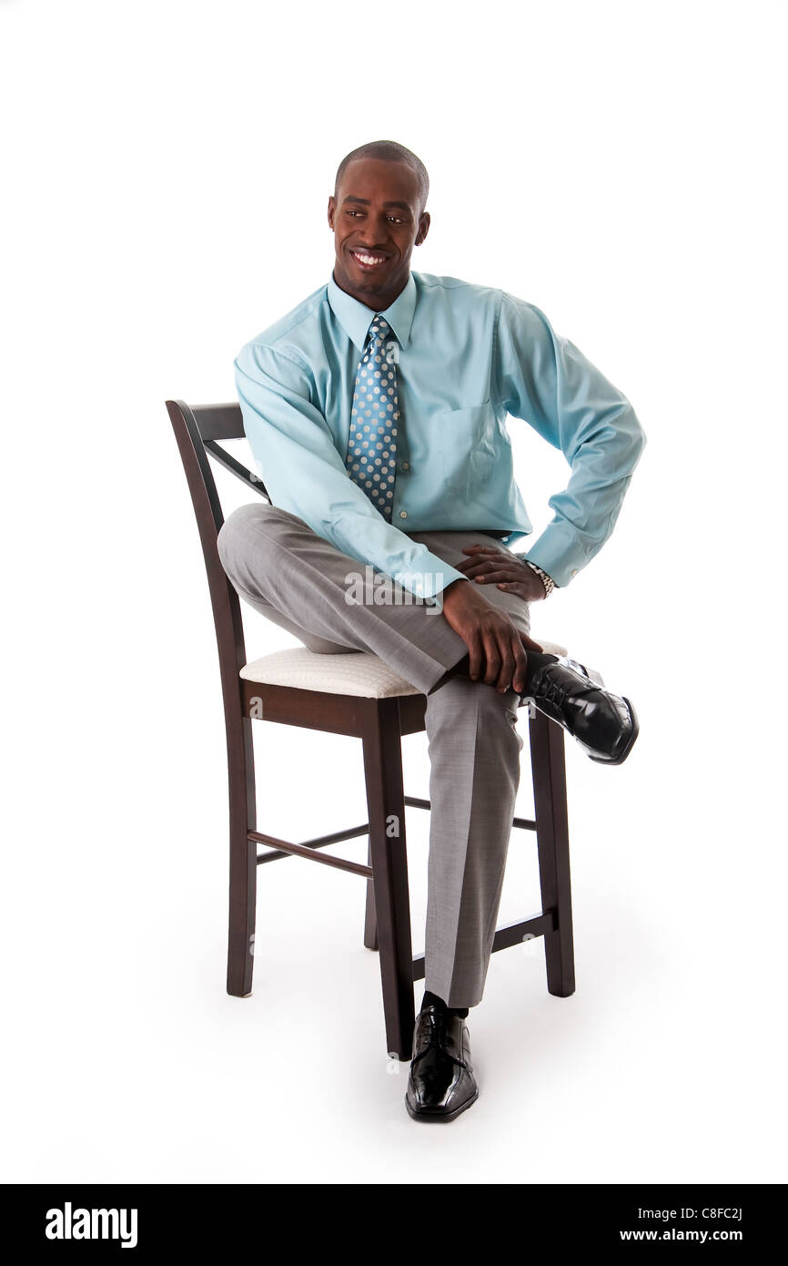 Business man on chair - Stock Image
