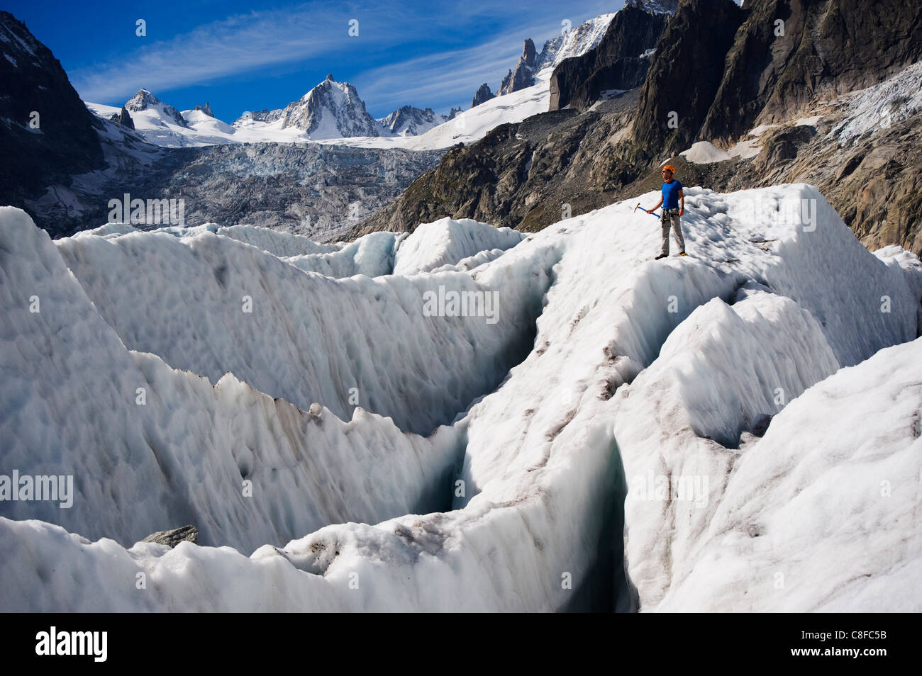 Aclimber in a crevasse field on Mer de Glace glacier, Mont Blanc range, Chamonix, French Alps, France Stock Photo