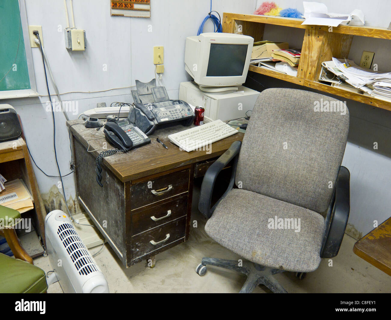 Very dirty and disorganized office in a concrete manufacturing office - Stock Image