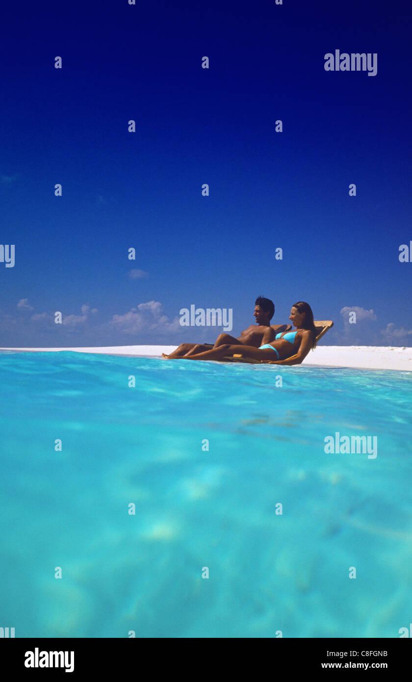 Couple on a beach, Maldives, Indian Ocean - Stock Image