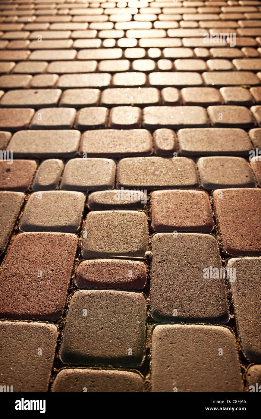 Brick pattern of pavement - Stock Image