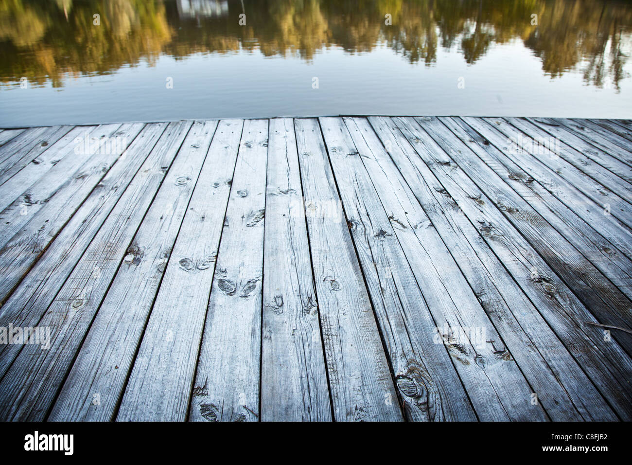 Close up shot of old wooden pier. - Stock Image