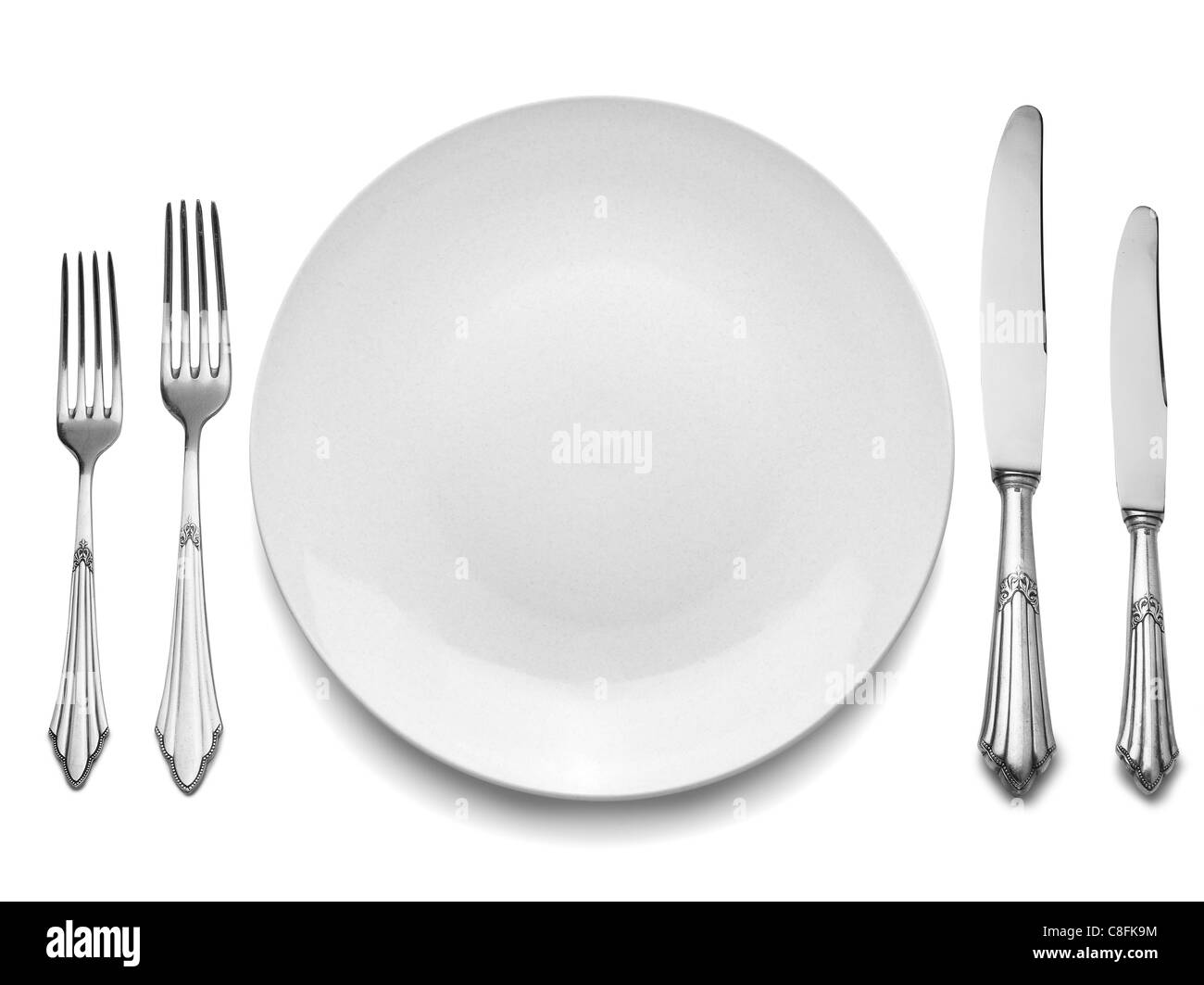 Setting with Plate, Knifes & Forks (clipping path) - Stock Image
