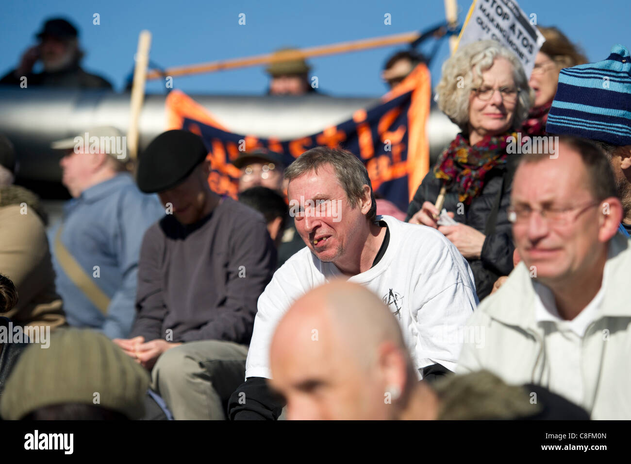 Saturday 22nd October 2011, Queens Way, London. Member of the publiclistens intently to the speakers protesting - Stock Image