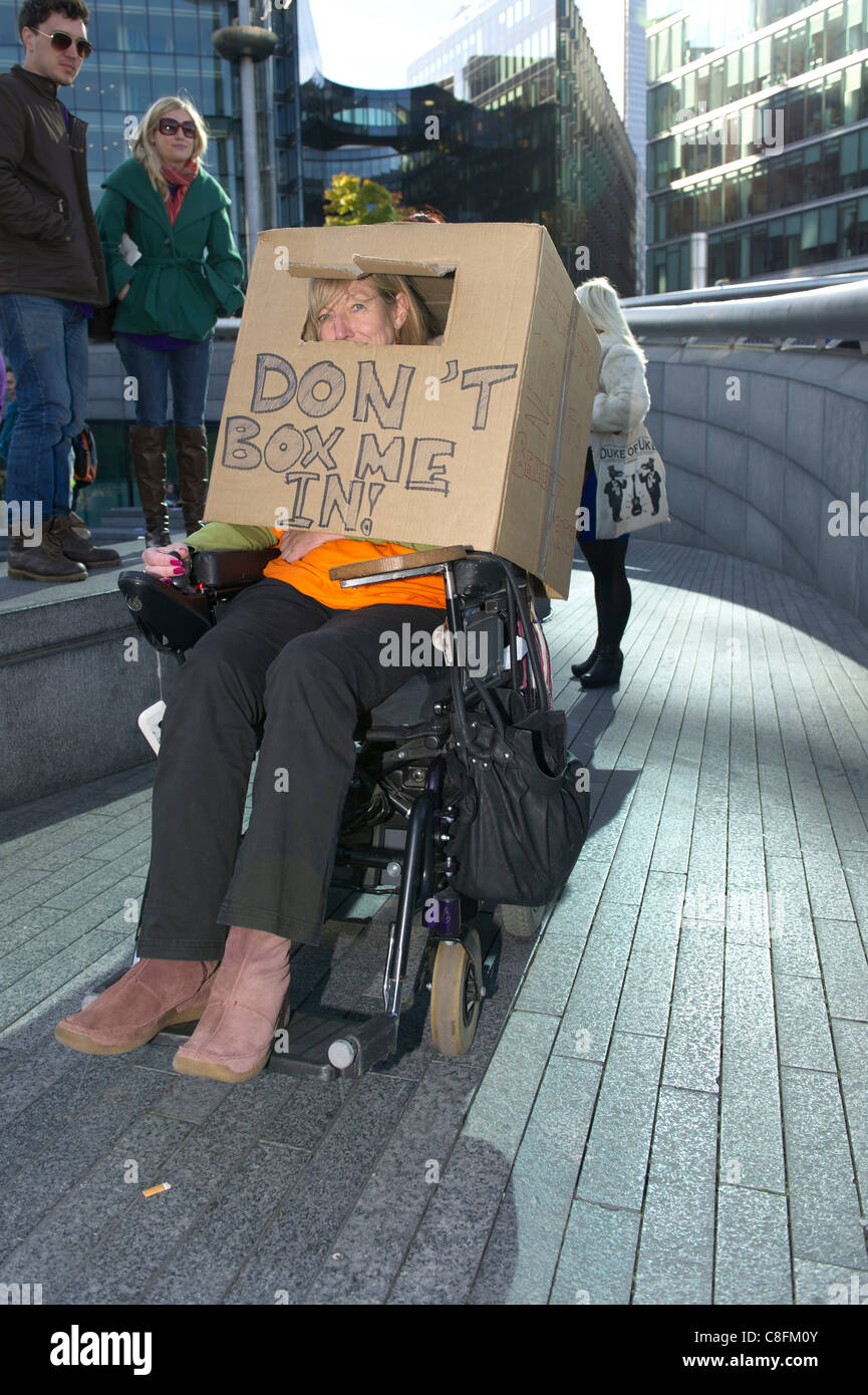 Saturday 22nd October 2011, Queens Way, London. A wheelchair bound woman wears a cardboard box on her head at a - Stock Image