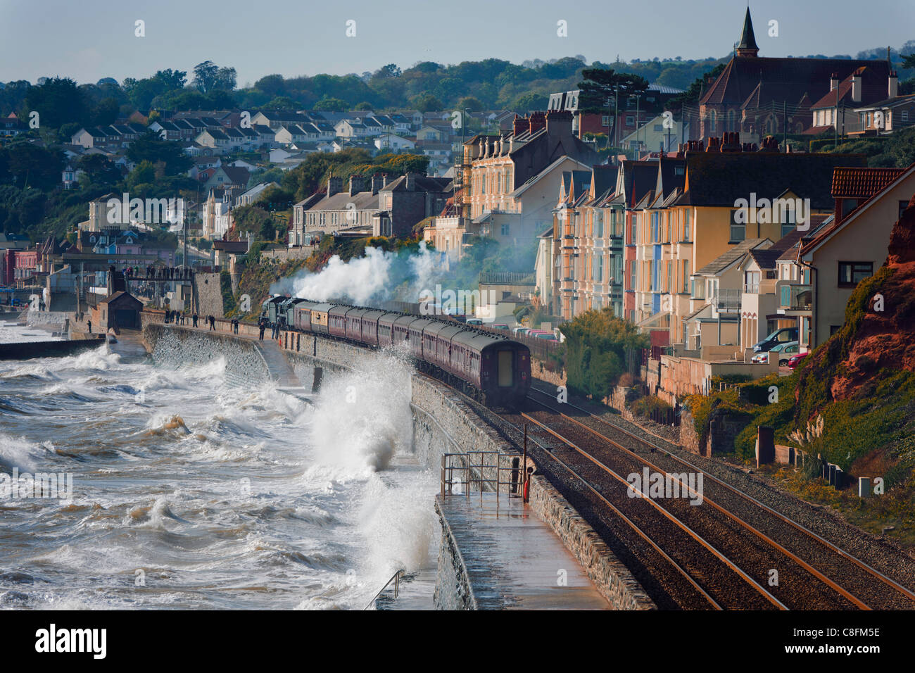 The Devonian double headed by steam locomotives 6024 King Edward I and 70013 Oliver Cromwell approaches Dawlish - Stock Image
