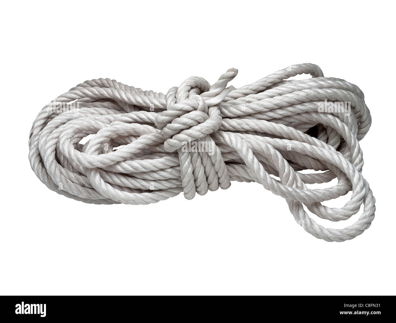 roll of rope isolated on white - Stock Image