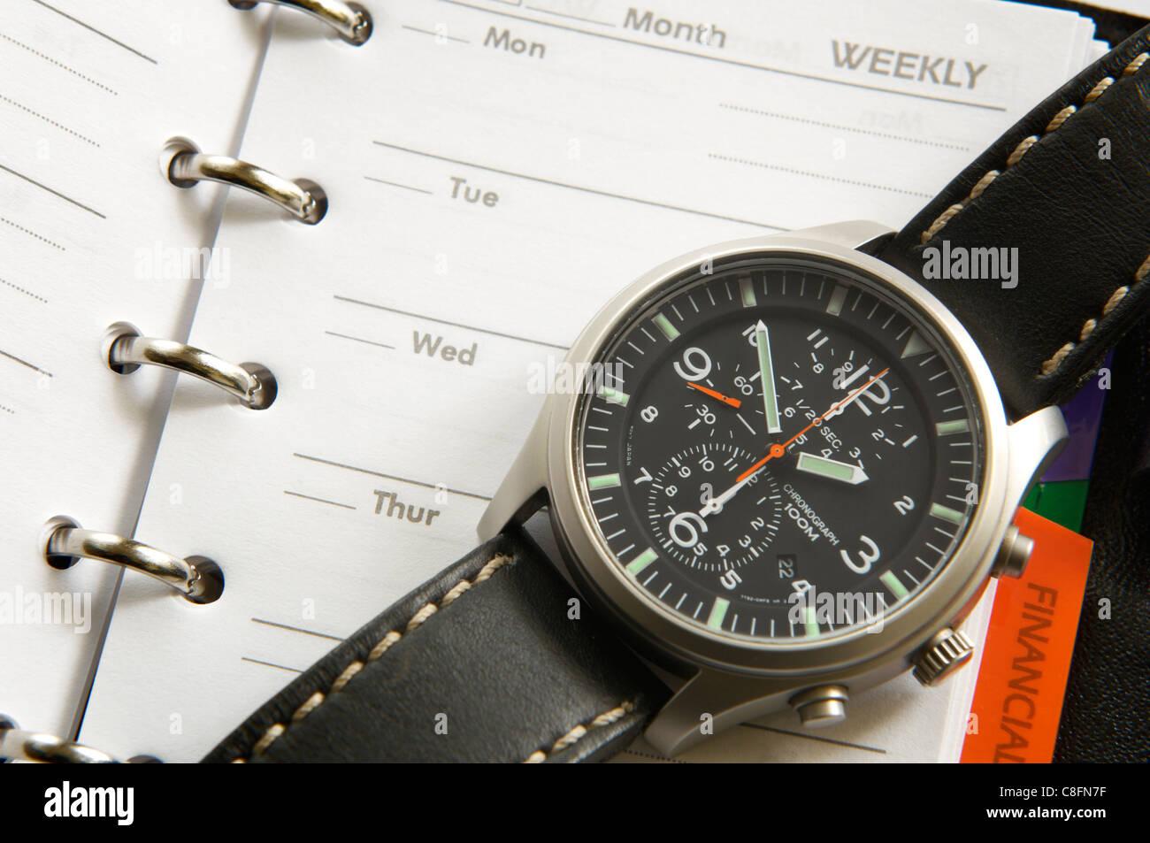 Macro photograph of an organizer and wrist watch - Stock Image