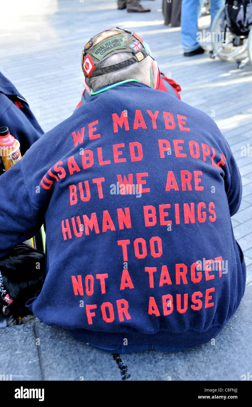 Welfare Reform Bill protest A disabled man with a slogan on his jacket at The Hardest Hit protest against benefit Stock Photo