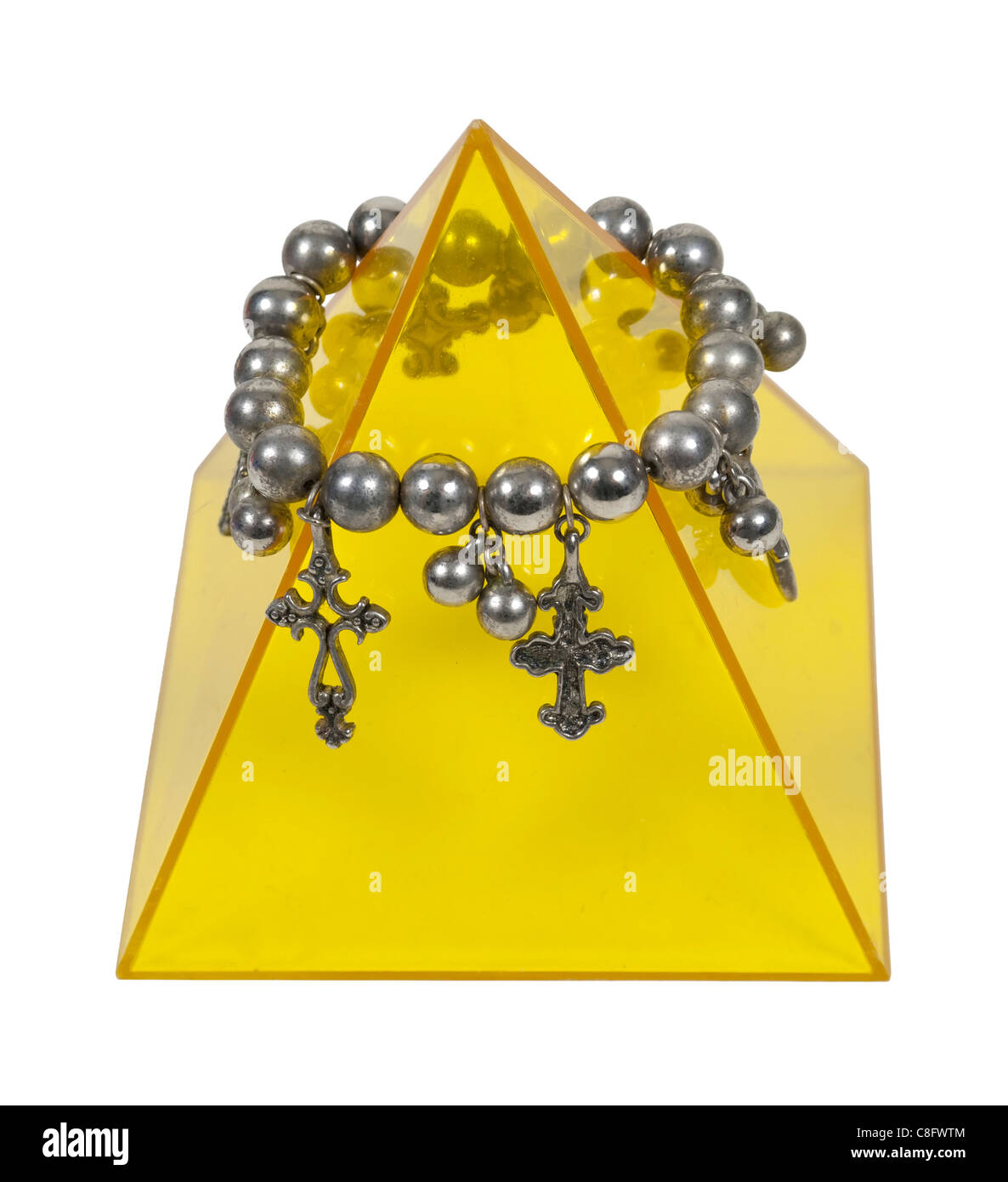 A yellow pyramid adorned with silver crosses - path included - Stock Image