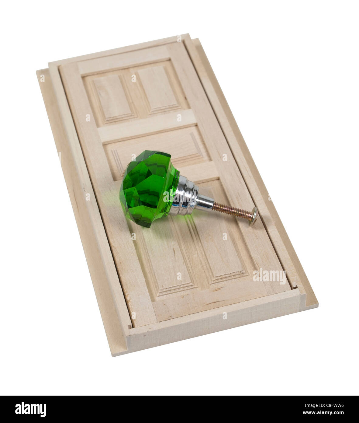 Wooden interior door with five panels used to gain entrance to another room with green doorknob - path included - Stock Image