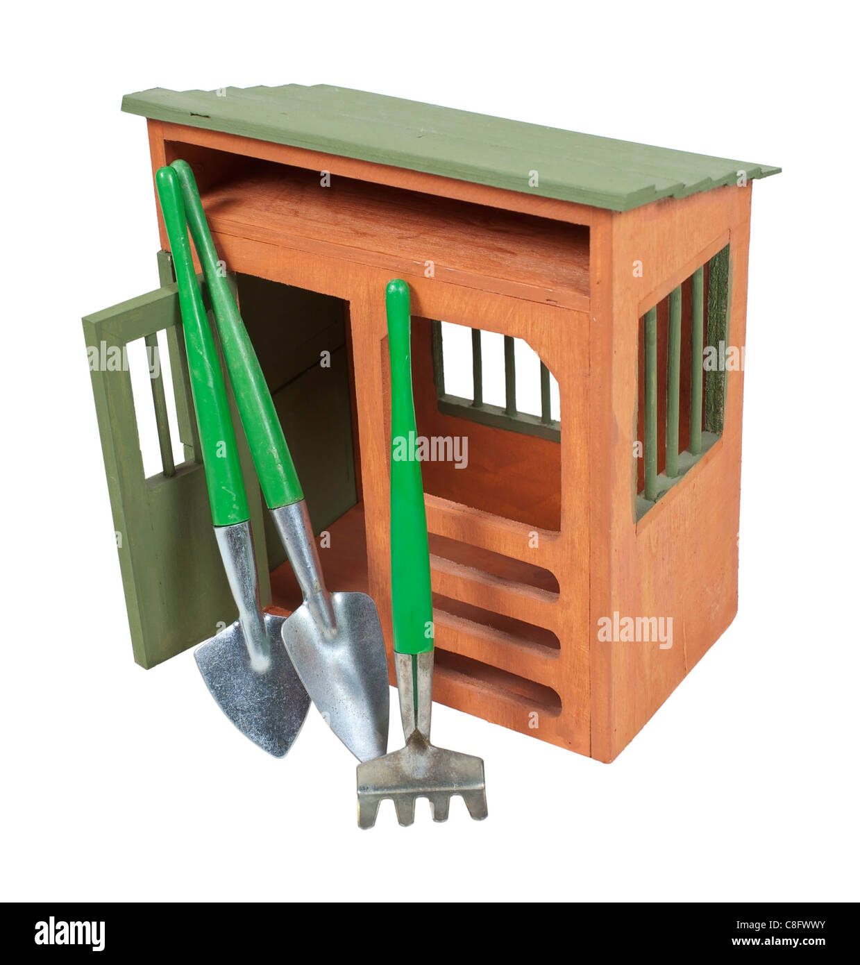 Wooden garden shed with tools for tending plants - path included - Stock Image