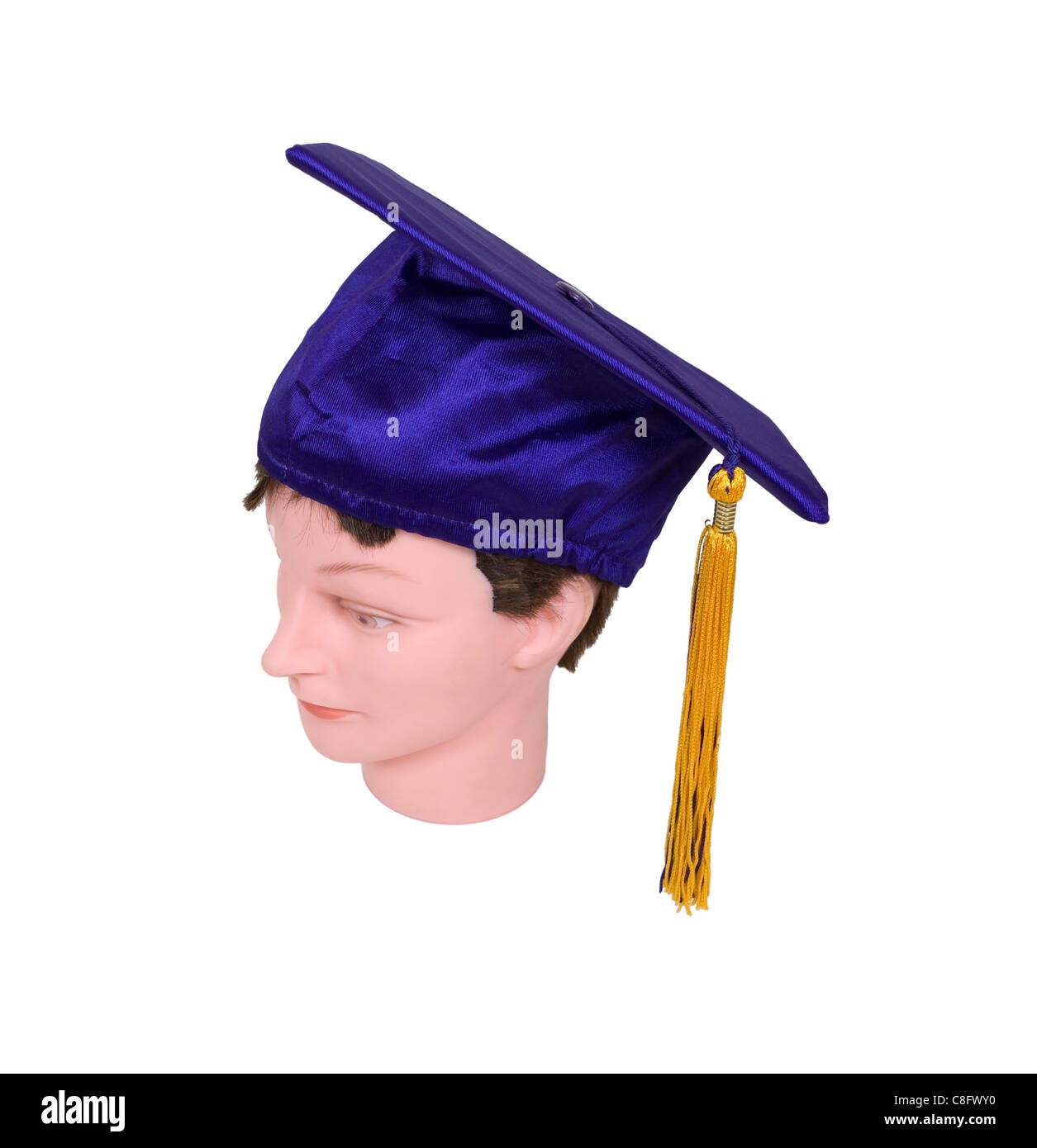 Male graduate wearing the graduation mortar board with tassel used during ceremonies - path included - Stock Image