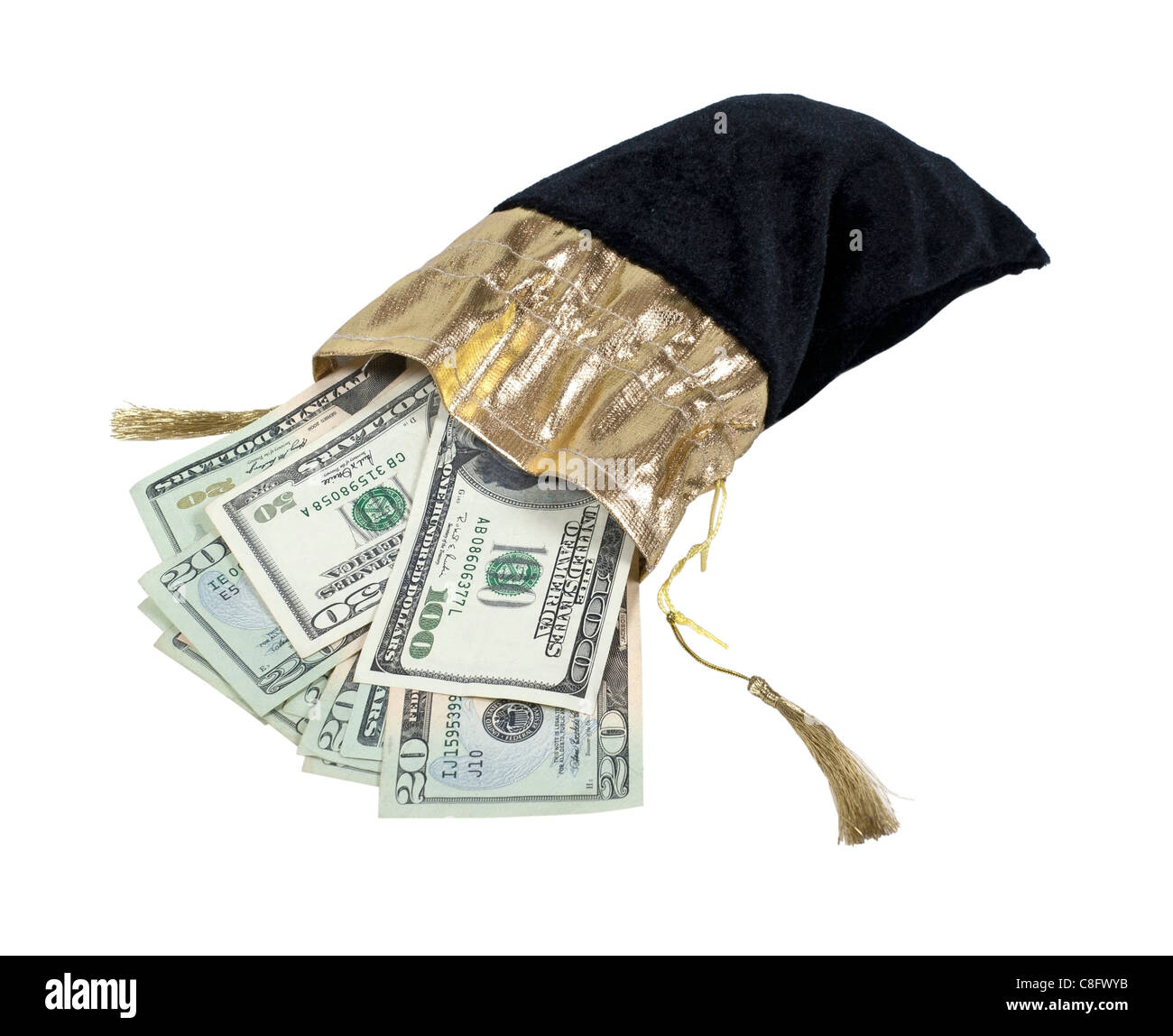 Money in the form of many large bills in a black velvet drawstring bag with golden accents - path included - Stock Image