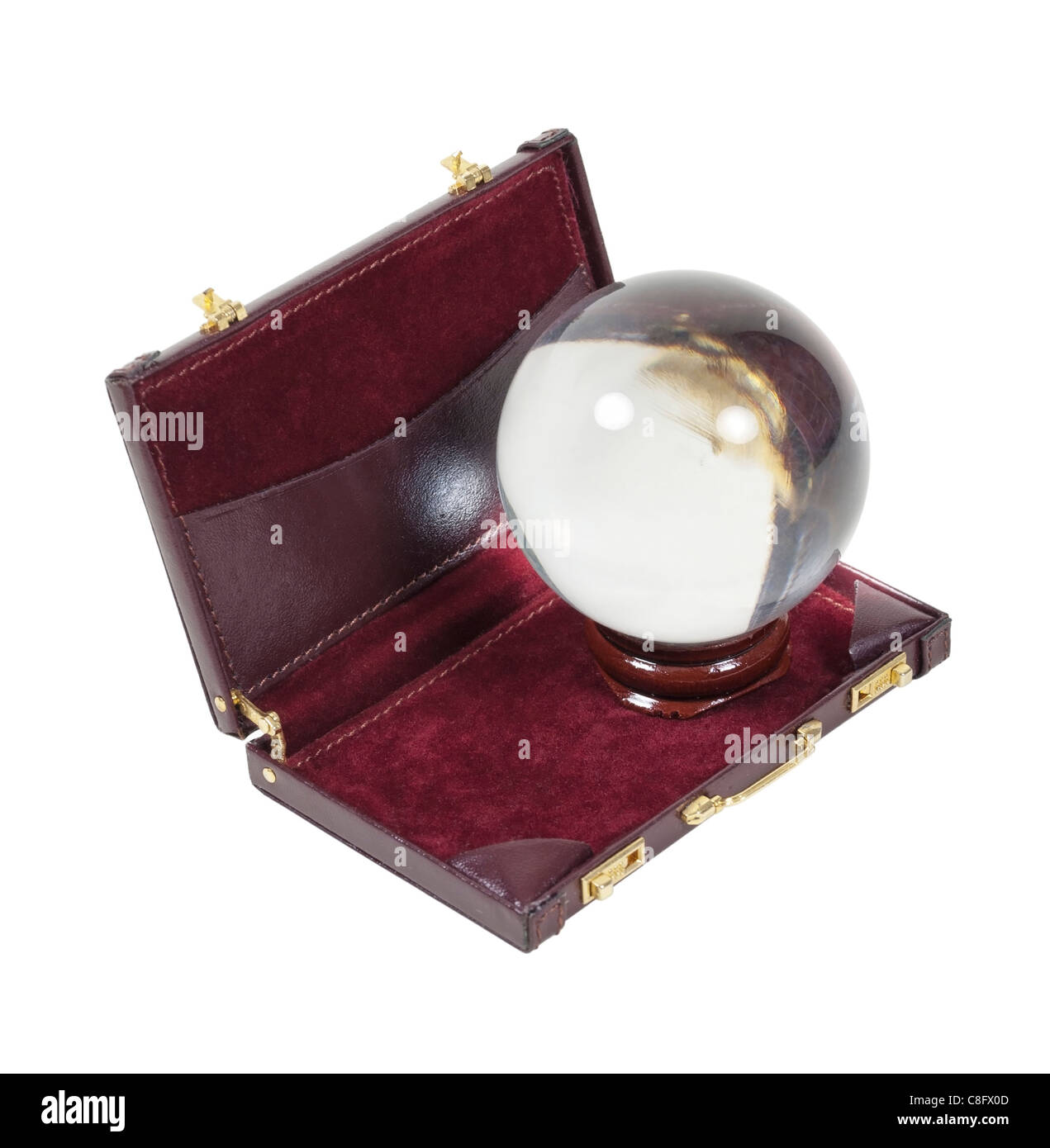 Predicting business shown by a crystal ball in a briefcase - path included - Stock Image