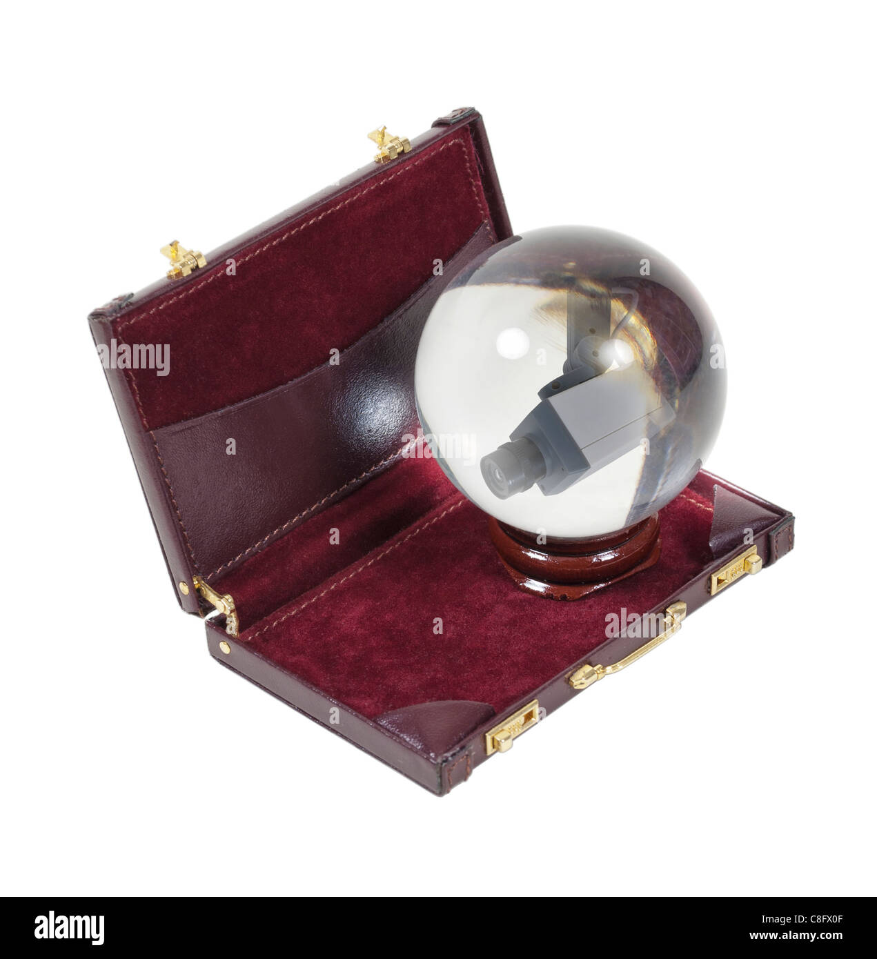 Predicting secure business shown by a security camera in a crystal ball in a briefcase - path included - Stock Image