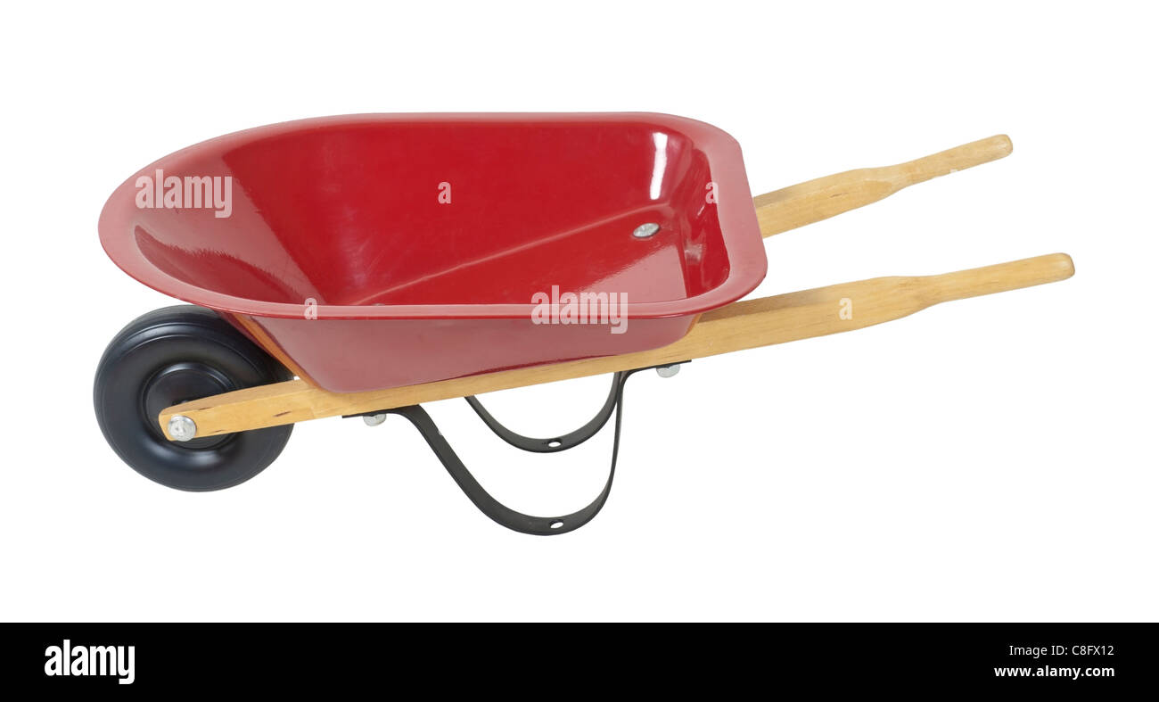 Red wheelbarrow used to transport items while working outdoors - path included - Stock Image