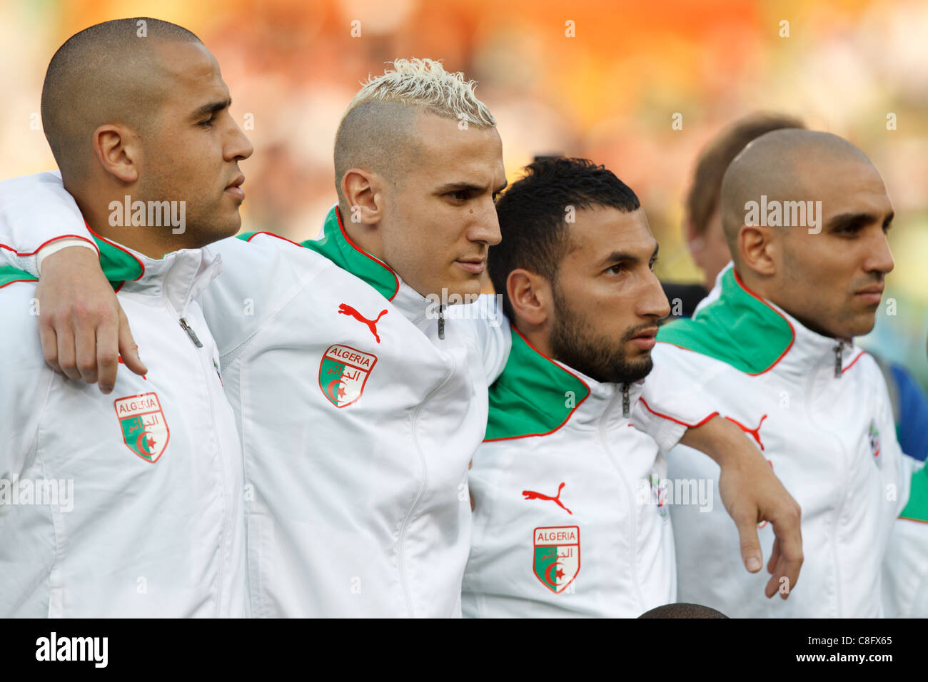 Algeria players line up for team introductions before a 2011 FIFA World Cup Group C match against the United States. - Stock Image