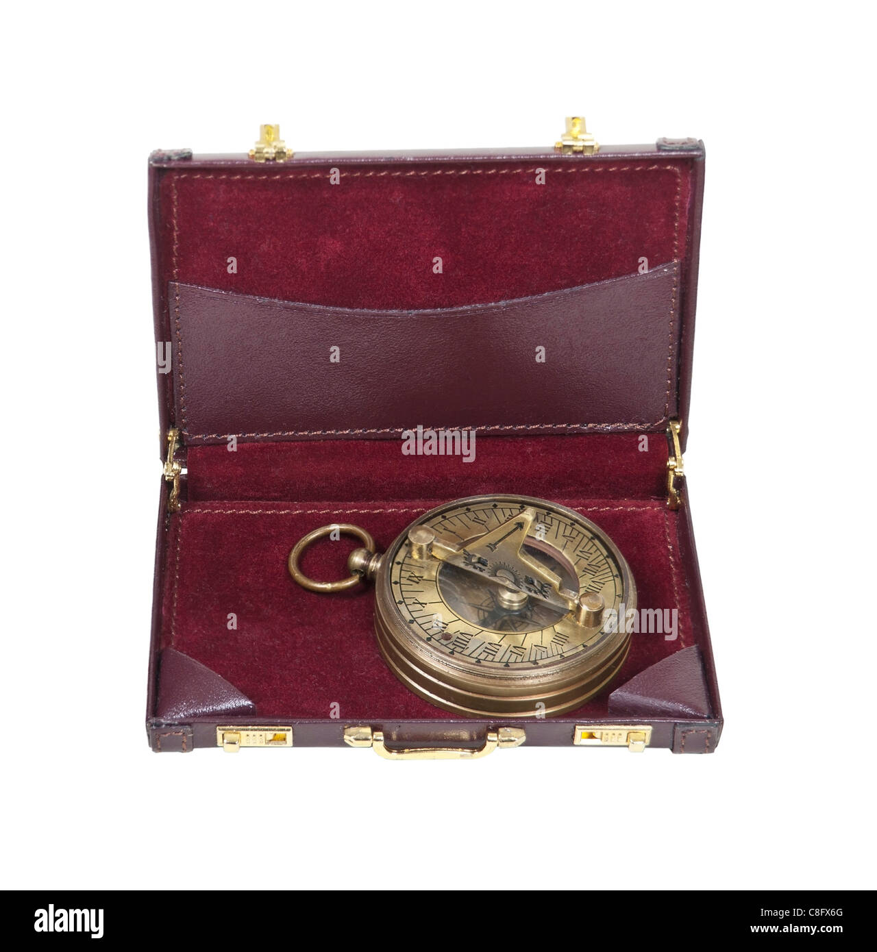 Brass sundial used to tell time as referenced by the sun in a leather briefcase - path included - Stock Image