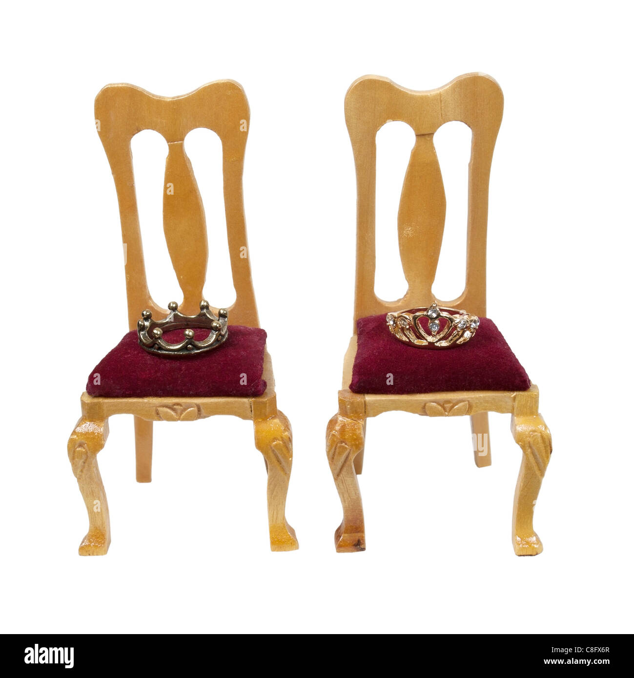 Thrones of the king and queen with velvet seats and royal crowns - path included - Stock Image