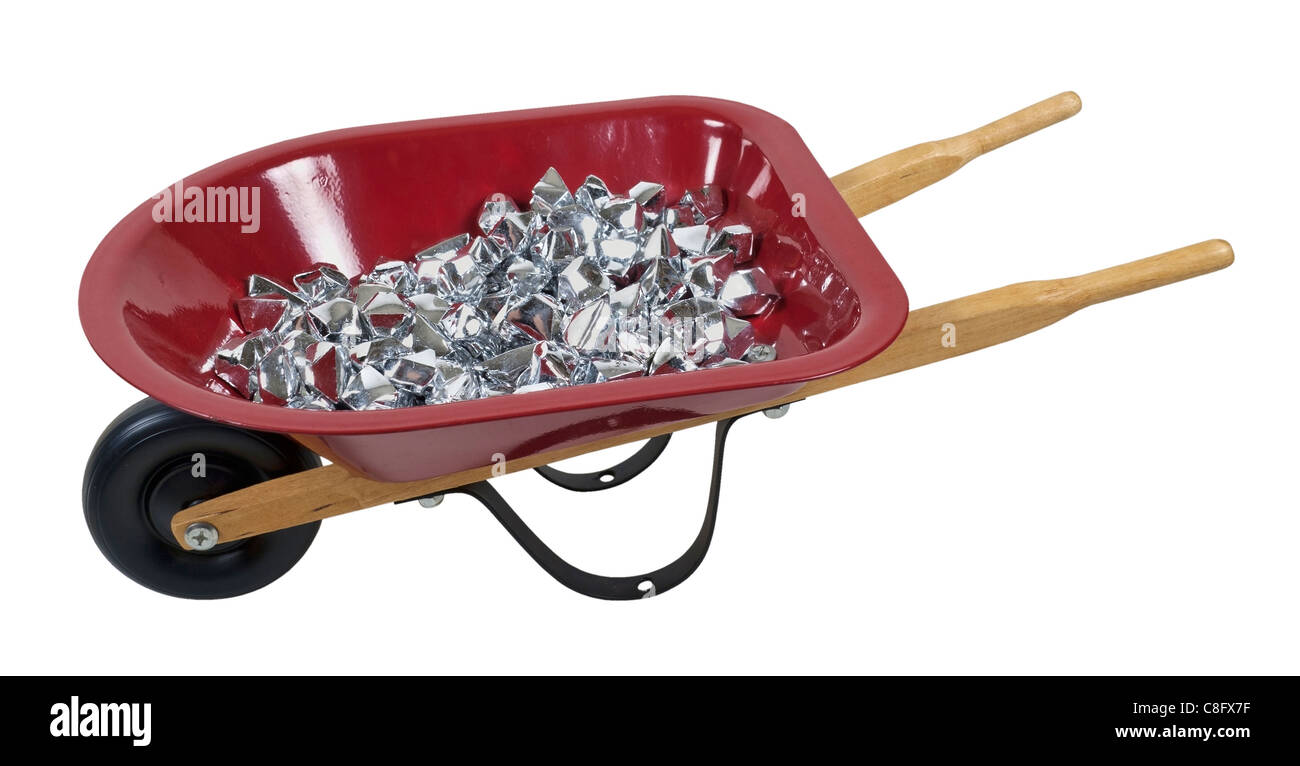Wheelbarrow full of silver stones of random shapes - path included - Stock Image