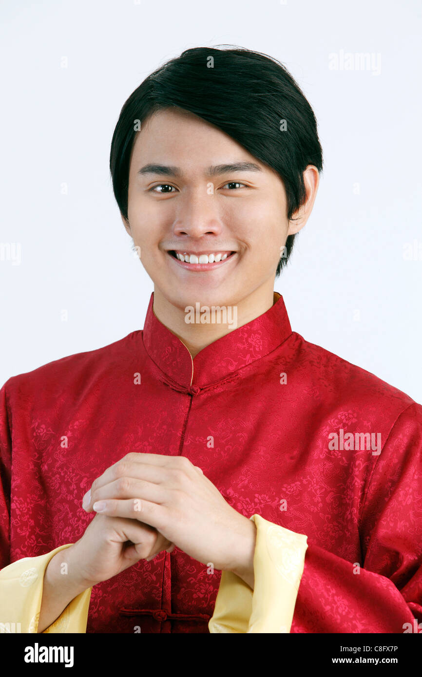 d61969a45 man in Chinese traditional clothes greeting you a Chinese New Year ...