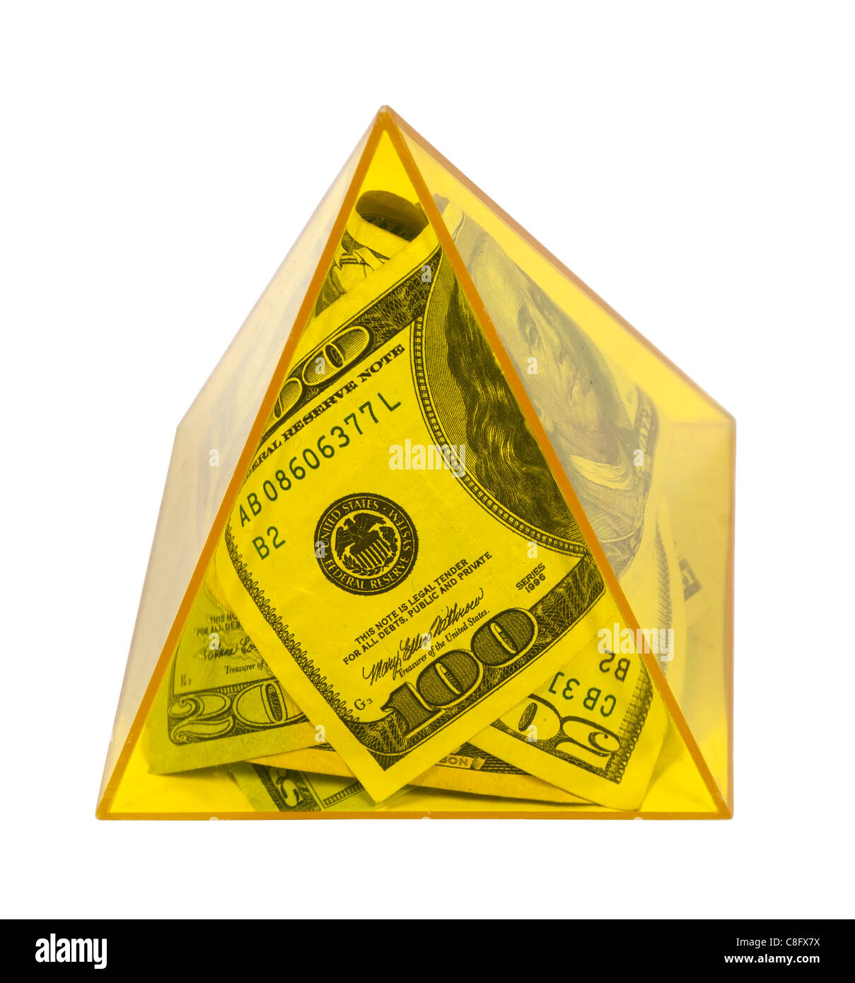 Money stuffed into a large yellow pyramid in a symbol of power - path included - Stock Image