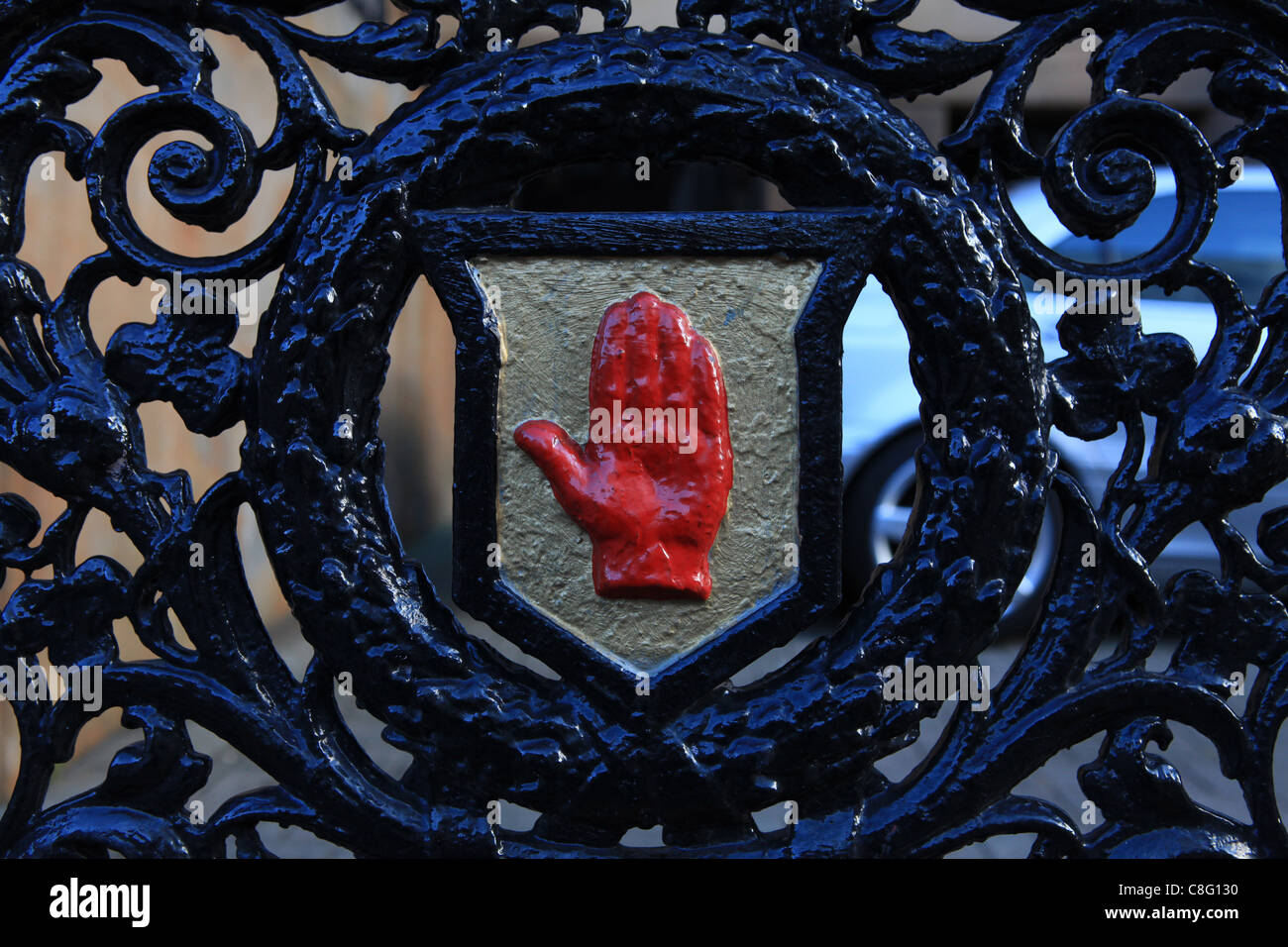 The Red Hand of Ulster is pictured on a medal gate in Belfast - Stock Image