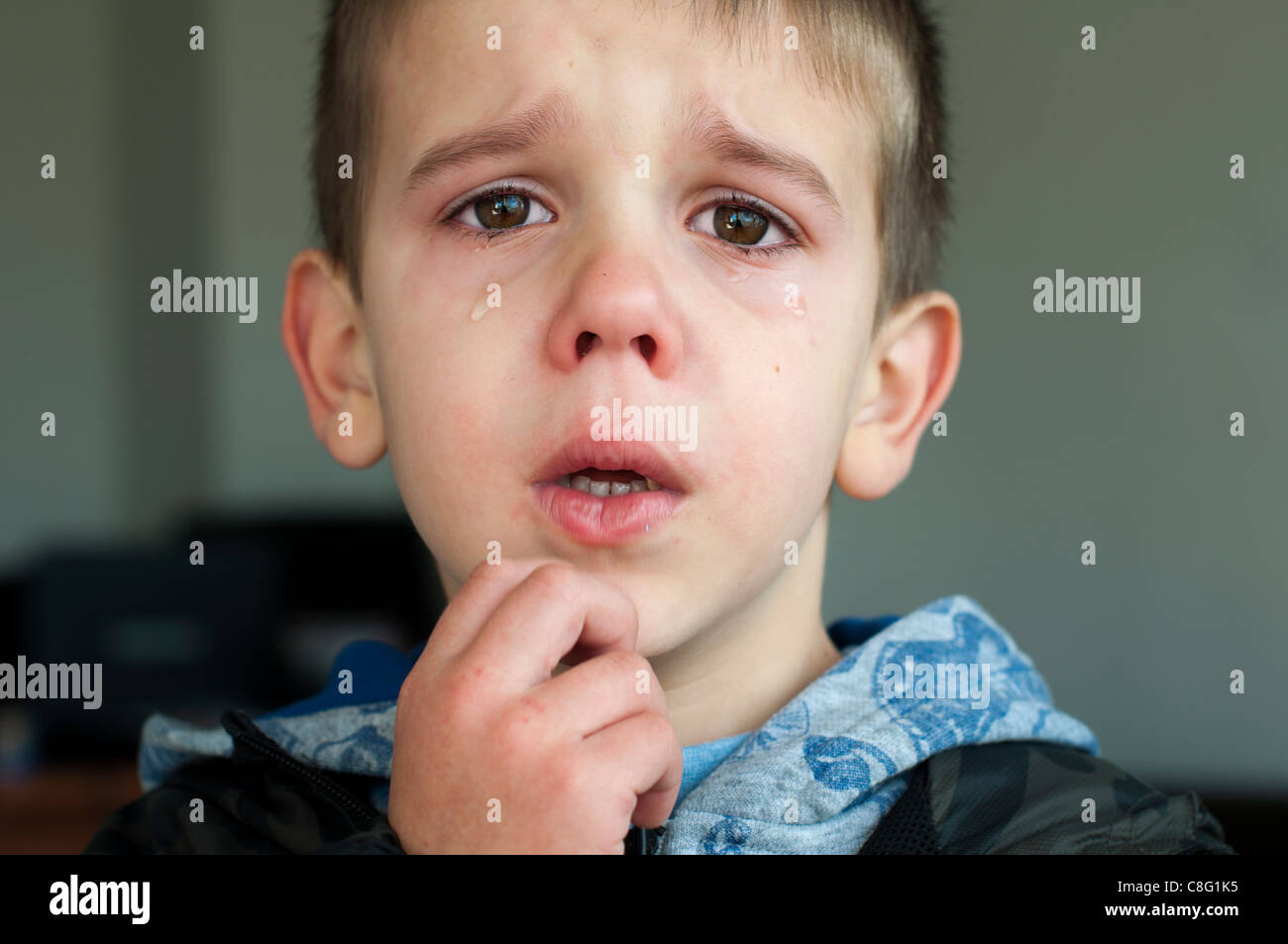 Sad child who is crying. Close up - Stock Image