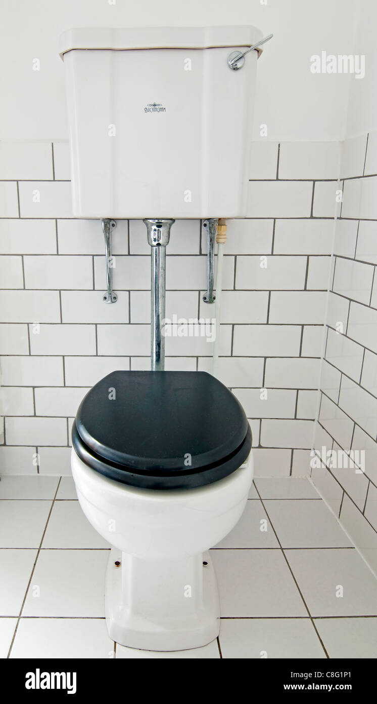 A view of a modern bathroom with a classically styled Victorian toilet - Stock Image