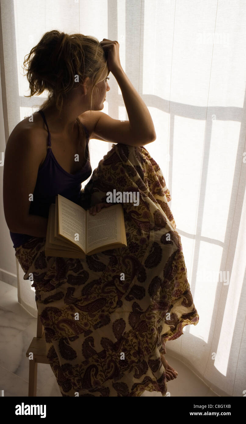 Young woman with book. - Stock Image