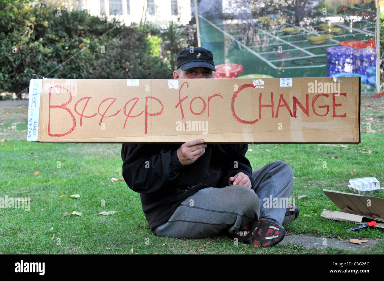 Beeep for change banner and a protester at The Occupy London protest spreads to Finsbury Square in the financial - Stock Image
