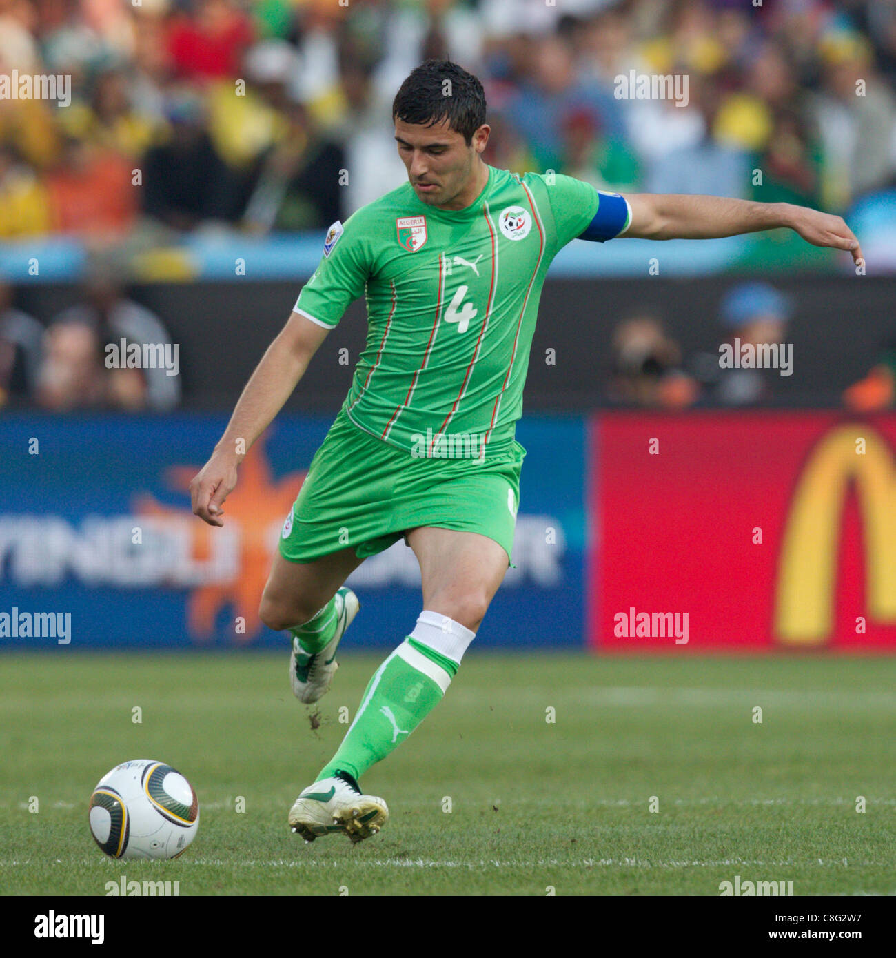 Algeria team captain Anther Yahia passes the ball during a 2010 FIFA World Cup Group C match against the United - Stock Image
