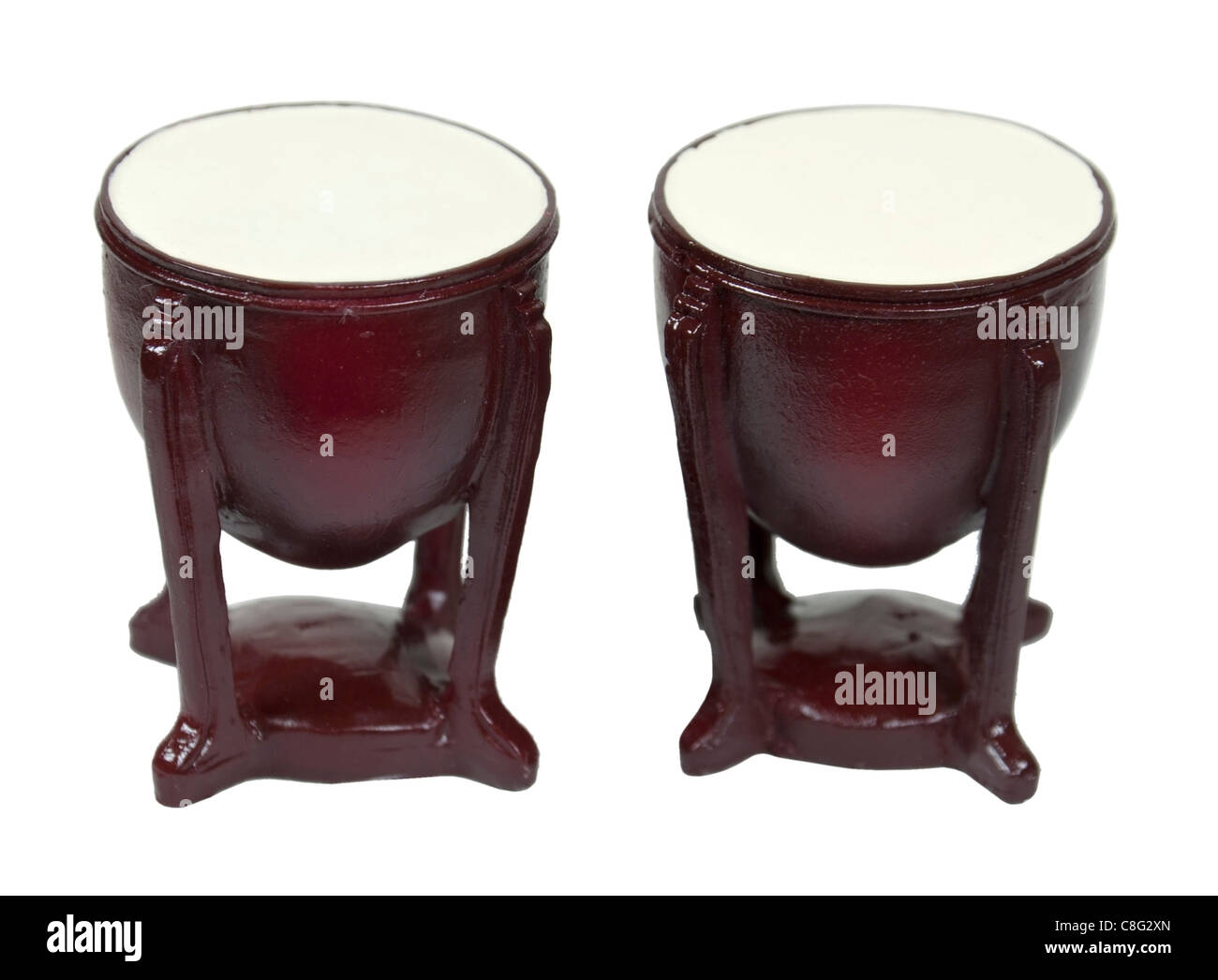 Wooden bongo drums musical instruments with stands - path included - Stock Image
