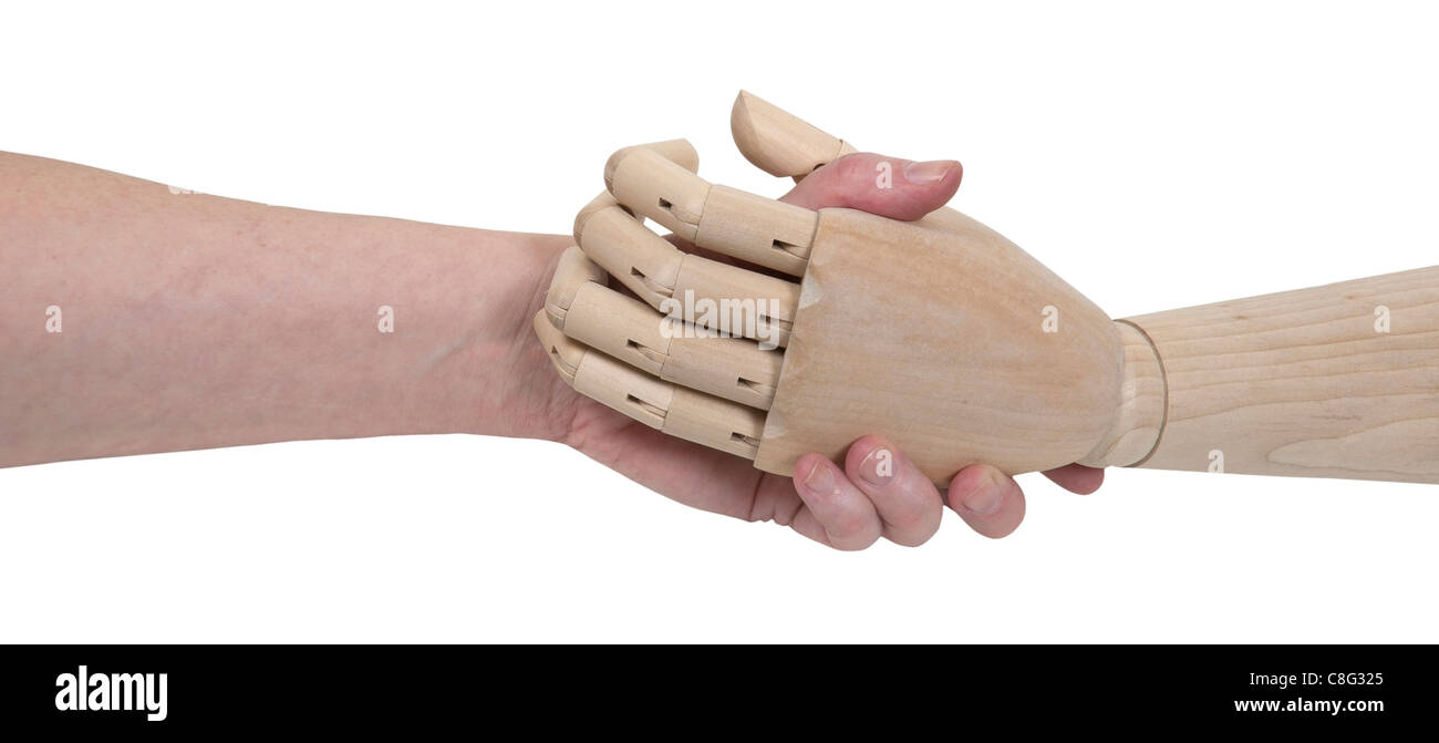 Impersonal agreements shown by an agreement handshake with a wooden figure that is not human - path included - Stock Image