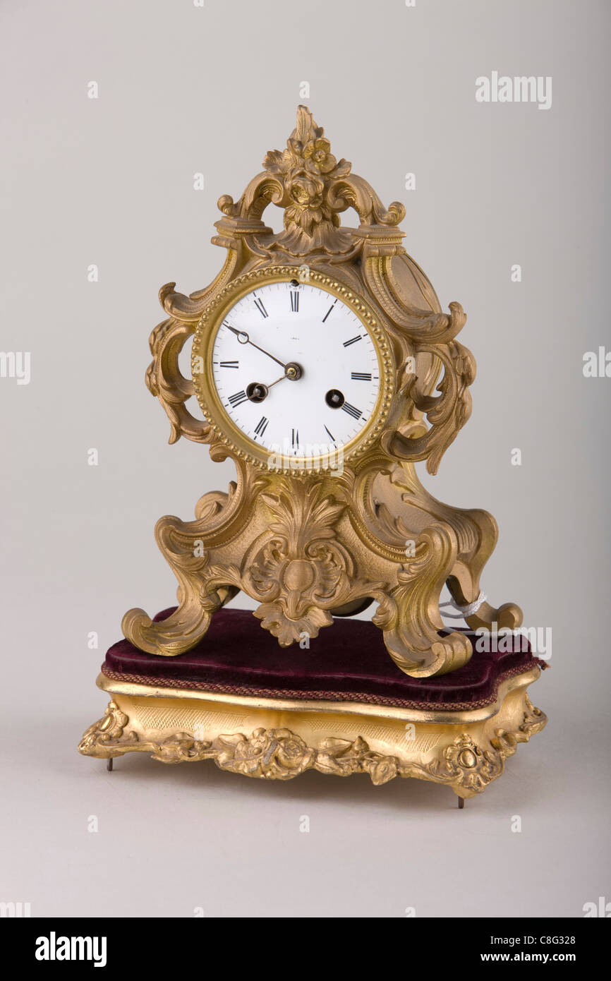 Old clocks are photographed on a plain background - Stock Image