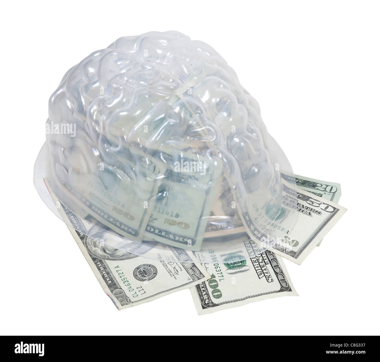 Money on the mind shown by money in the form of many large bills in a brain - path included - Stock Image