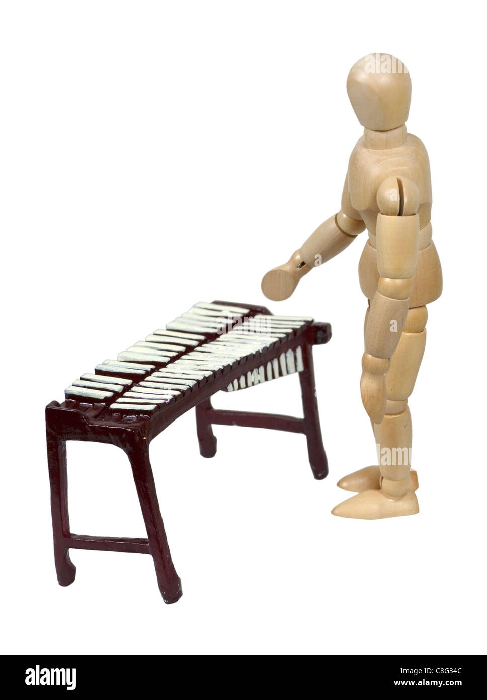 Playing a marimba musical instrument - path included - Stock Image