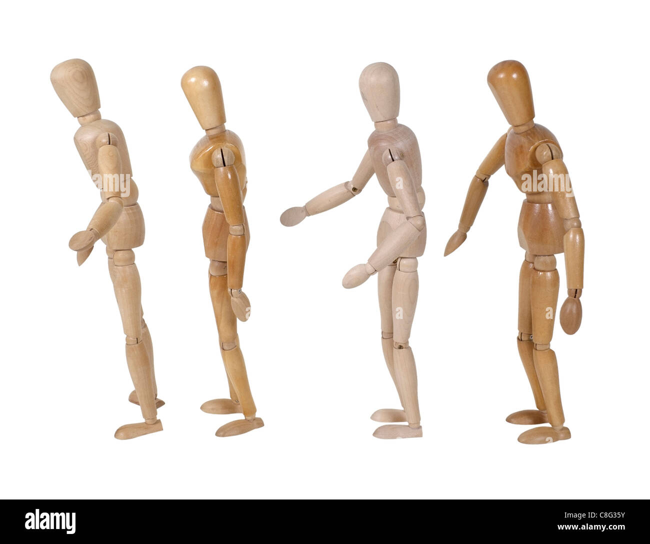 Wooden models representing people standing in line - path included - Stock Image