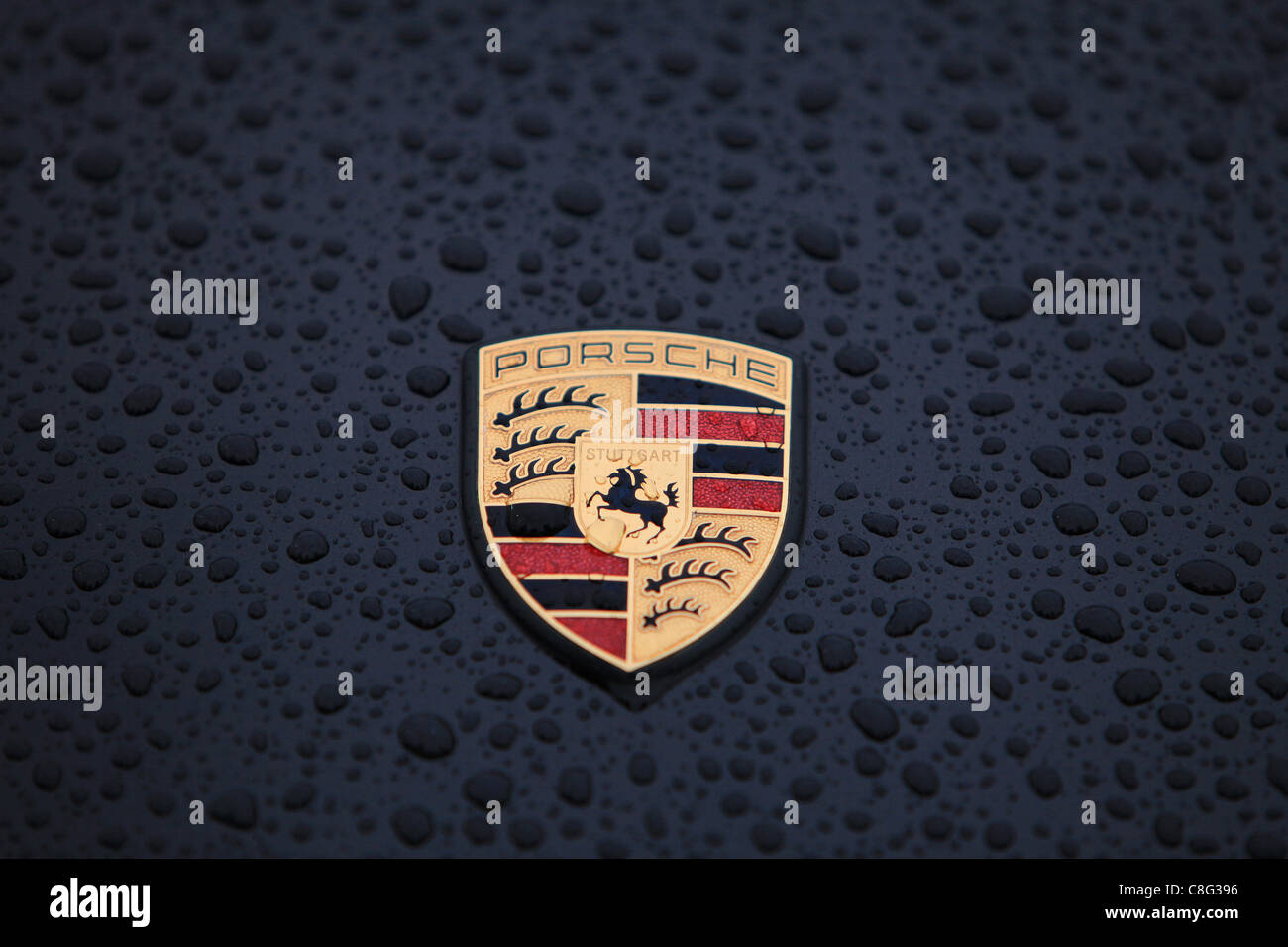 Close up of cars with rain drops on the bonnet (hood) of car - Stock Image