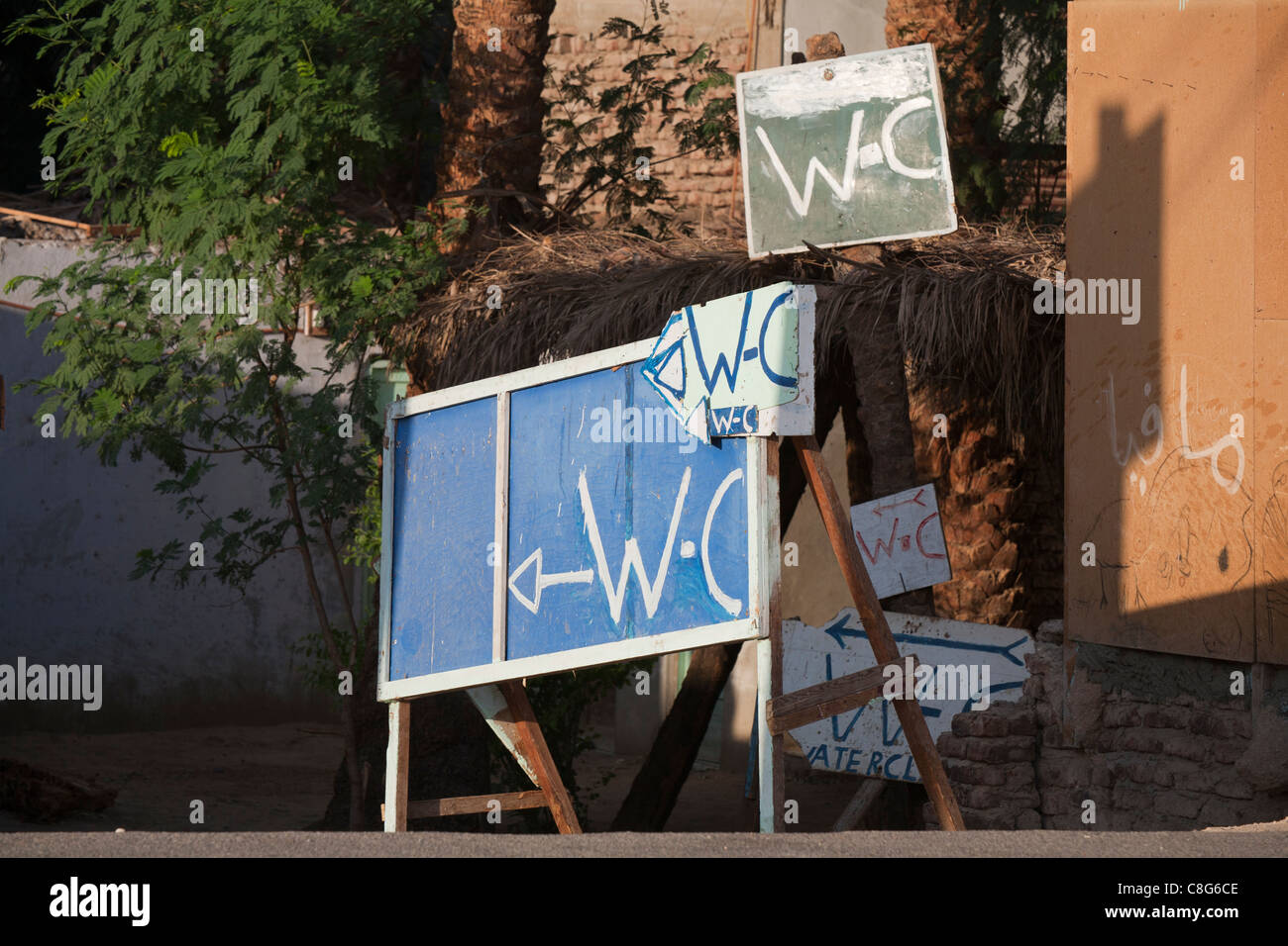Multiple WC signs on the road side, Luxor. Egypt, Africa - Stock Image