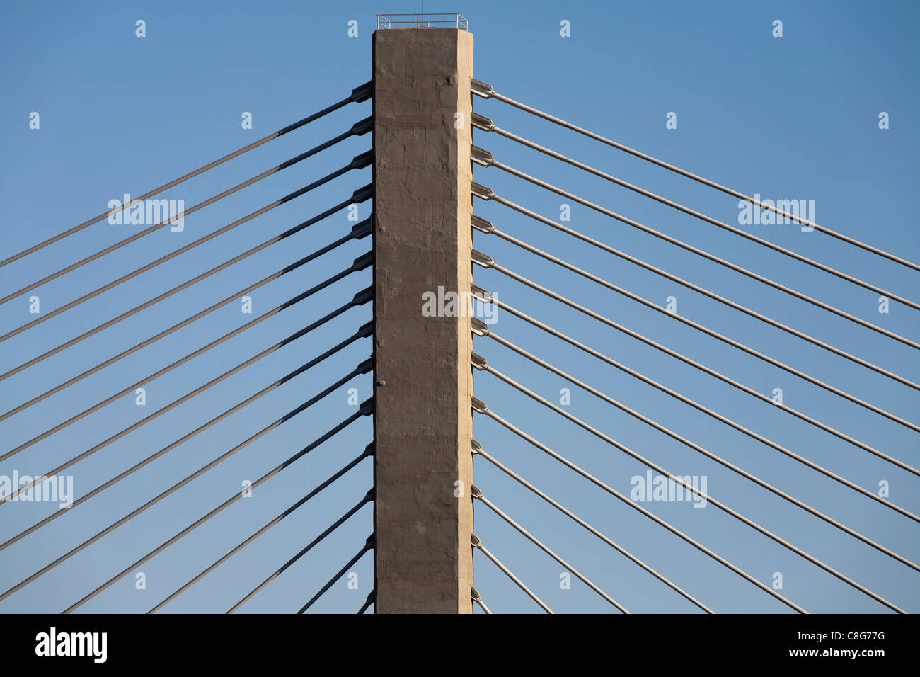 Close up details of cables fanning from a concrete tower of the Aswan suspension bridge spanning the river Nile, - Stock Image