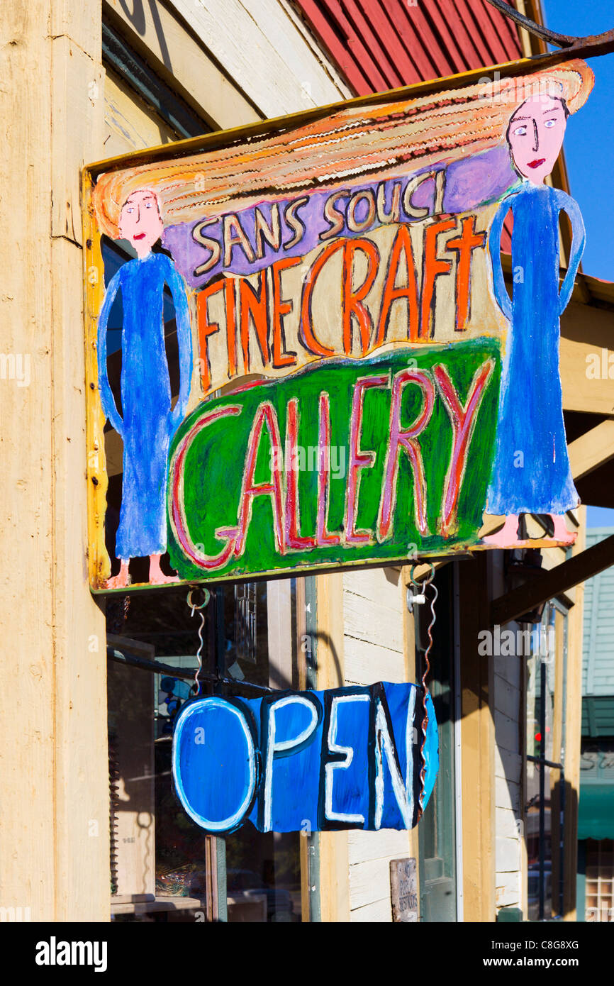 Sign for Sans Souci craft gallery on East Vermilian Street in downtown Lafayette, Lousiana, USA - Stock Image
