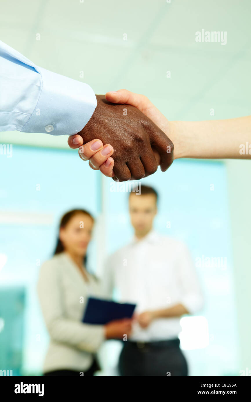 Shaking hands in office after conclusion of treaty - Stock Image