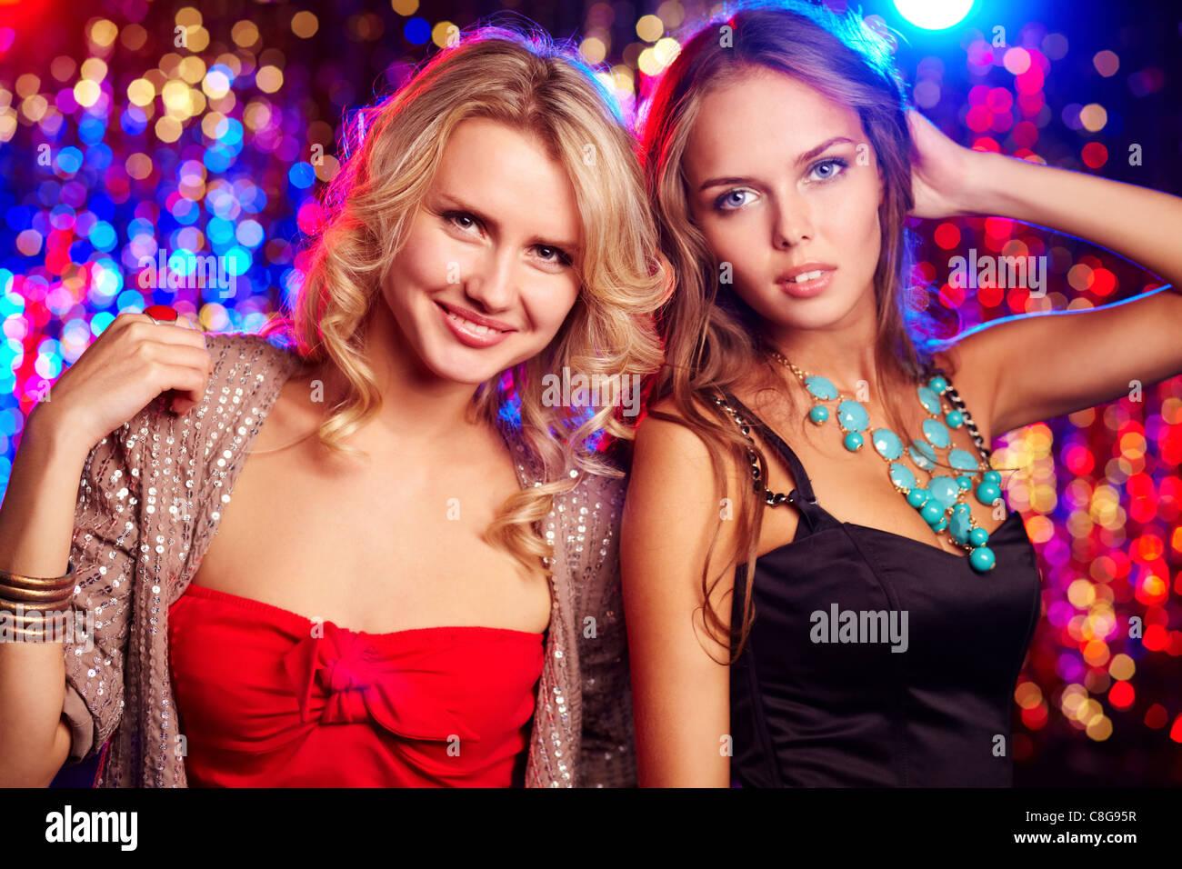 Portrait of two beautiful glamorous girls - Stock Image