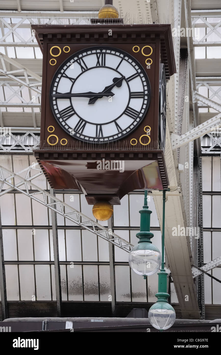Big cube four sided clock hanging from the glass roof of the Central Station rail terminal in Glasgow. - Stock Image
