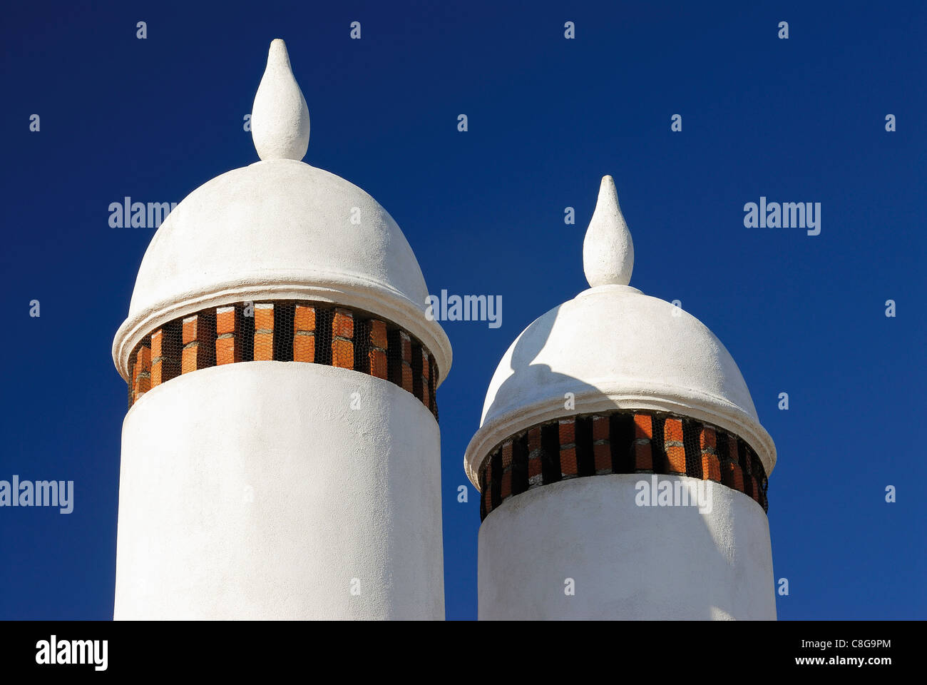 Portugal, Alentejo: Typical chimneys in the village Aldeia da Luz at the margins of the Barrage of Alqueva - Stock Image