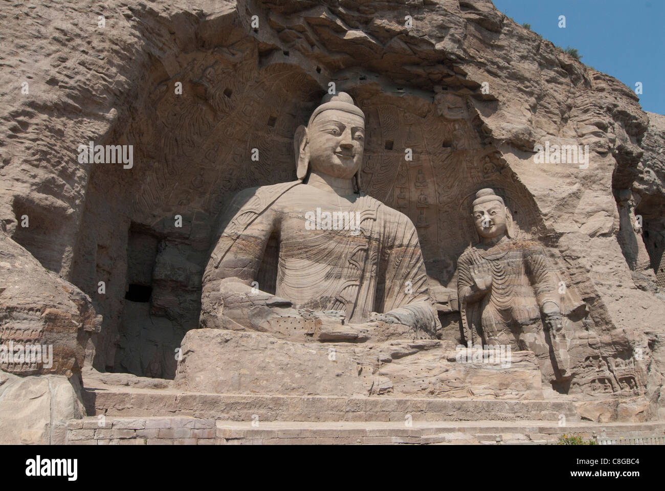Giant Buddhas at Yungang Grottoes, ancient Buddhist temple grottoes near Datong, UNESCO World Heritage Site, Shanxi, - Stock Image