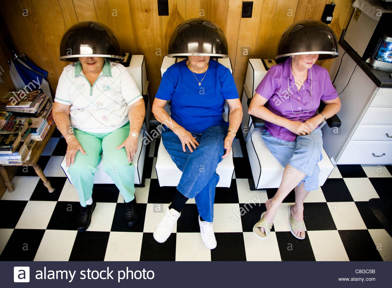 Women Sit Under Hair Dryers At A Rural Hair Salon In Georgia Stock