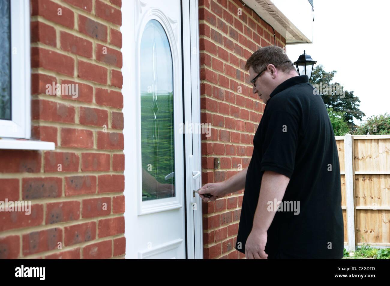 Unlocking Front Door Stock Photos Unlocking Front Door Stock